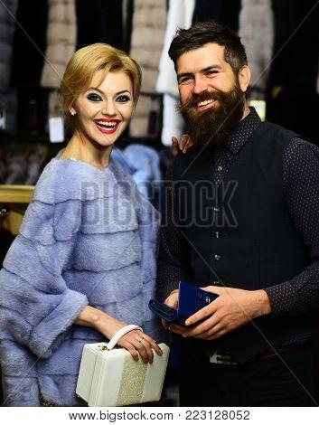 Guy With Beard And Woman Buy Furry Coat