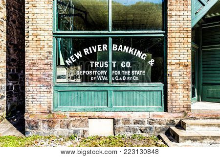 Thurmond, USA - October 19, 2017: Abandoned closed retro vintage building with Banking and Trust sign in West Virginia ghost town village closeup