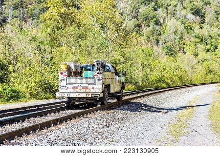 Thurmond, Usa - October 19, 2017: Railroad Rail With Csx Car Truck Riding In West Virginia Ghost Tow