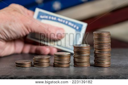 Increasing pile of US quarter coins showing increase in pension or  social security increases as retirement age grows