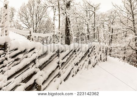 Roundpole fence, a fencing typical for Norway, Finland, Sweden and Estonia. Fence is covered in snow in the Norwegian winter.