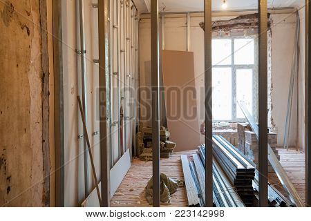 Interior of upgrade apartment with materials during on the remodeling, renovation, extension, restoration, reconstruction and construction. ( Making wall from gypsum plasterboard).