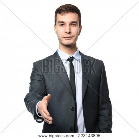 Car salesman stretching hand for handshake, on white background