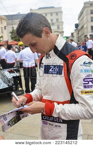 LE MANS, FRANCE - JUNE 16, 2017: British racing driver Oliver Jarvis team of Jackie Chan DC racing Oreca 07-Gibson. Parade of pilots racing at Le mans, France