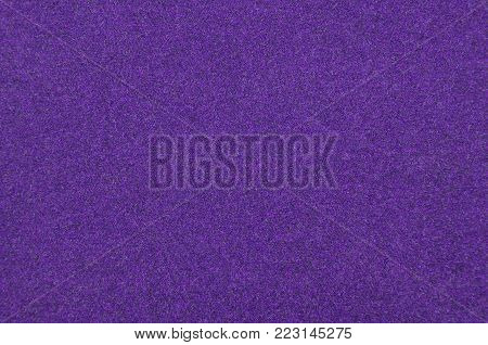 Close up of violet synthetical felt textured background