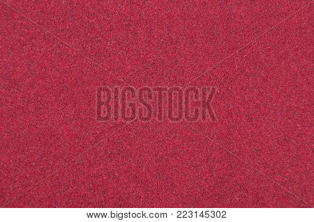 Close up of red synthetical felt textured background