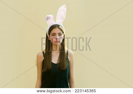 Easter Woman Posing In Profile On Beige Background