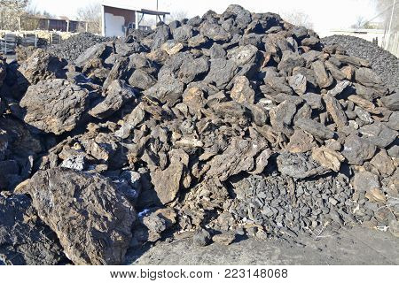 Coal in the outer warehouse is waiting for purchase and transportation.
