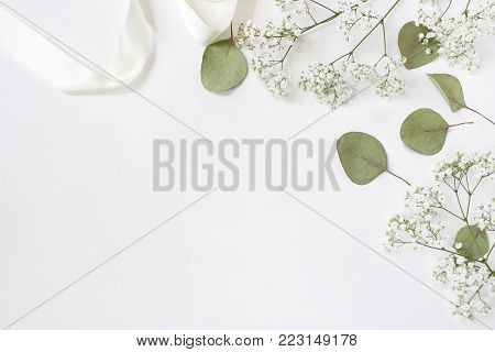 Styled stock photo. Feminine wedding desktop mockup with baby's breath Gypsophila flowers,