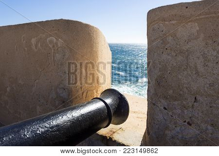 CASCAIS, PORTUGAL - October 3, 2017: Artillery (cannon) pointing out towards the ocean at the fort of Sao Jorge, erected during the Portuguese Restoration War with Spain, near Cascais, Portugal