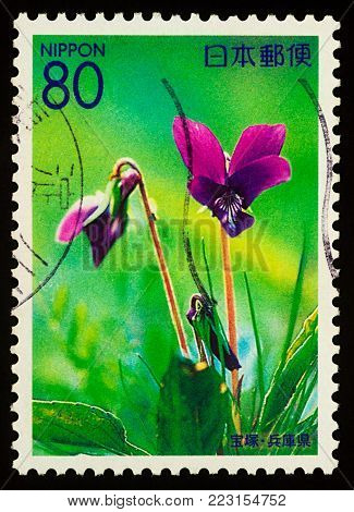 Moscow, Russia - January 22, 2018: A stamp printed in Japan shows violets on the meadow, series