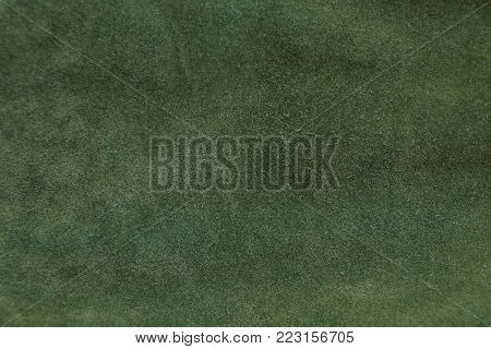 green fabric texture from a piece of cloth clothes