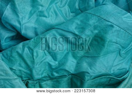 green minted fabric background of a piece of clothing