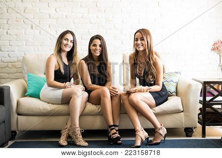 Group of female friends and roomies all dressed up and ready for a night out together