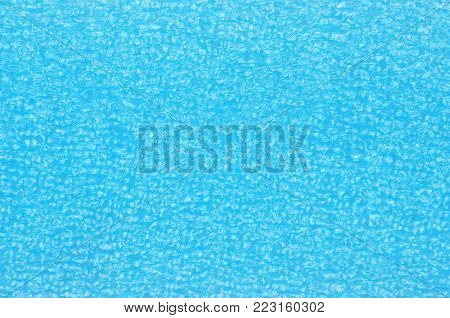 Blue foamed rubber, close up as background