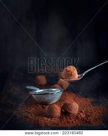 Chocolate truffles. Homemade fresh truffle dark chocolate candies with cocoa powder made by chocolatier. Gourmet food, delicious dessert