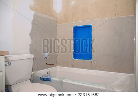 A bathroom remodeling project ready for tile to be put around the tub