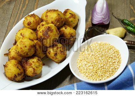 Top down view of Gluten free Moong Daal goli or mung lentil spicy balls cooked in a spicy masala.