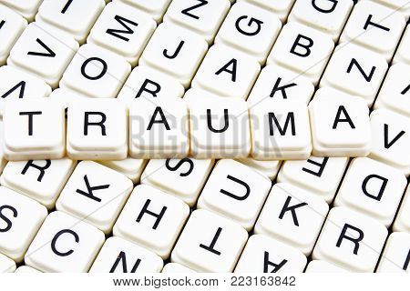 Trauma text word crossword title caption label cover background. Alphabet letter toy blocks. White alphabetical letters.Trauma.