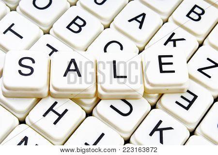Sale text word crossword title caption label cover background. Alphabet letter toy blocks. White alphabetical letters. Sale.