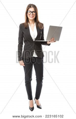 Portrait of a gorgeous young woman with glasses working in tech support and wearing a suit