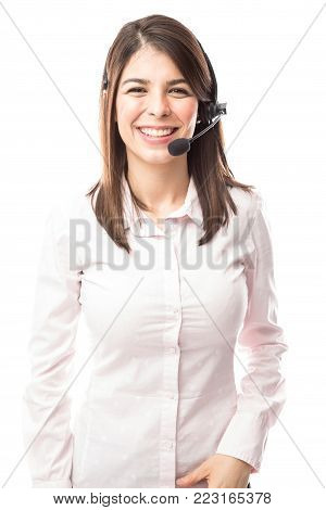 Portrait of a beautiful young Hispanic woman working as a tech support representative in a call center