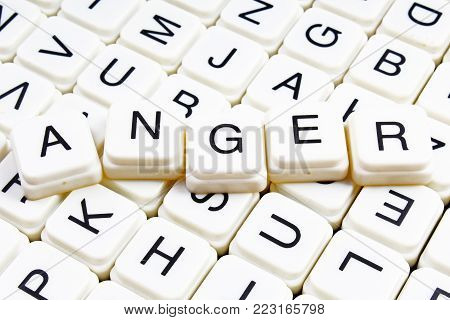 Anger text word crossword title caption label cover background. Alphabet letter toy blocks. White alphabetical letters. Anger.