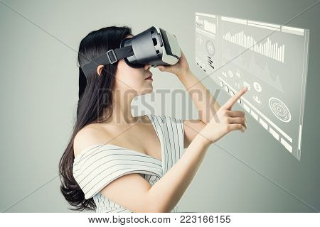 woman wore a virtual reality headset that simulates, And touch screen technology graph. the reality and looked up to see what the virtual reality was capable of rendering.