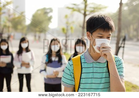 teenagers student wearing mouth mask against smog in city