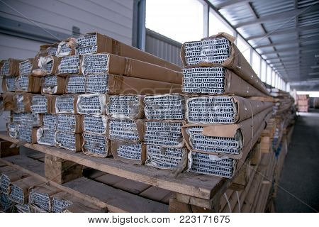 Packed galvanized aluminum parts in the warehouse. poster
