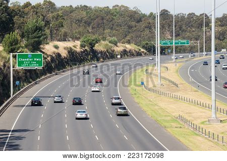Melbourne, Australia - January 4, 2015: Traffic outbound on the Eastern Freeway during the day, approaching the Chandler Highway exit.