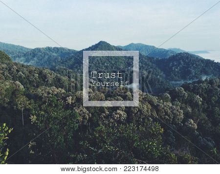 inspirational quotes poster by unknown source on high mountain background in morning glory sunrise with complete forest show nature.