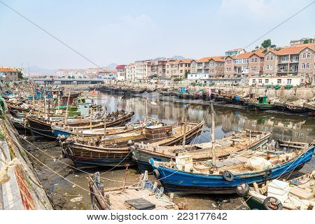 Wooden fishing boats in the village of Shazikou, in the outskirts of Qingdao, Shandong, China