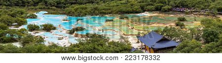 Huanglong National Park, Sichuan, China, famous for its colorful pools formed by calcite deposits. Multi-colored Pond in the picture is the world's largest cluster of open air ponds, 3576m elevation