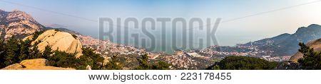 Fishing villages and Yellow sea panorama from Na Luo Yan Ku trail in Laoshan Mountain, Qingdao, China