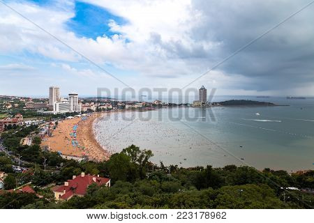 View of bathing beach N1 from the hill of Xiao Yu Shan Park in a rainy day in summer, Qingdao, Shandong province, China