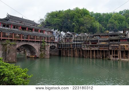 Hong Bridge in Fenghuang Ancient town, Hunan province, China. This ancient town was added to the UNESCO World Heritage Tentative List in the Cultural category.