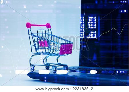 Double Exposure Shopping Cart Trolley With Laptop Notebook And Stock Market Display, E-commerce And