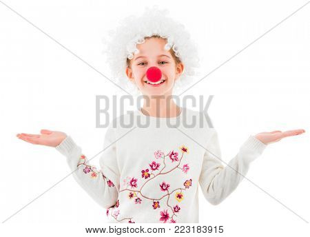 Cute teen girl in white clown wig and big red nose showing two empty palms and looking at camera isolated on white background. Copyspace