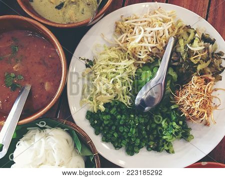 Variety Of Local Vegetables Having With Curry Rice Noodle And Mixed Many Kind Of Sauce For Thai Rice