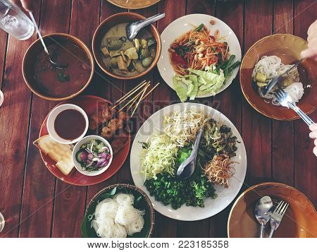White Thai Rice Flour Noodle Or Rice Vermicelli On Banana Leaf In Wooden Basketwork On Table. Thai S