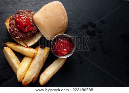 hand ground beef burger with wedge potatoes stock photo