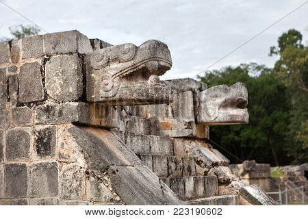 Ancient Sculpture at Chichen Itza, Yucatan, Mexico. Snake's heads