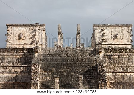 close and top view of the Mayan Warriors Temple in Chichen Itza, Yucatan Peninsula, Mexico
