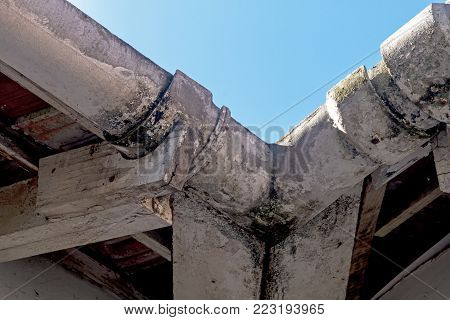 Neglected Vintage Mouldy Asbestos Gutters And Peeling Wooden Trusses