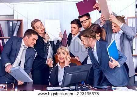 Mad business people office. Team people are unhappy with their leader. Crazy crowd in stress throw up their chief's papers. Documents for signature. How to avoid increasing voice in team.