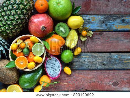 Mix Of Ripe Tropical Fruits With Avocado, Mango, Coconut, Carambola, Banana, Kumquat, Pitahaya, Kiwi