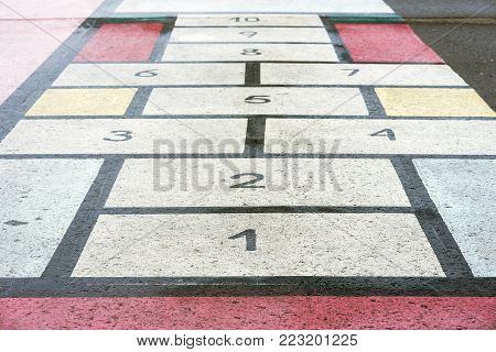 Classiic children game, hopscotch board drawn on asphalt, texture for modern creative background