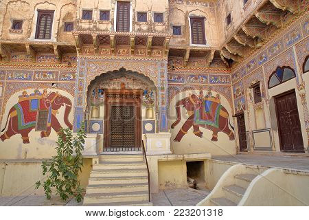 MANDAWA, RAJASTHAN, INDIA - DECEMBER 27, 2017: The entrance of a Haveli Home with frescoes and mural paintings