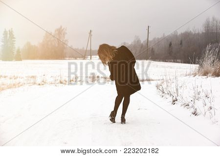 Slip on the slippery ice and snow on the road track at the country in freezing winter day.